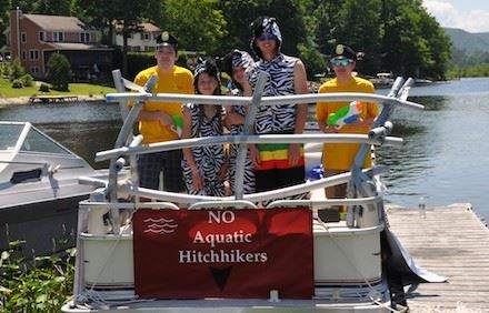 Lake St. Catherine Association Greeters participate in the boat parade.