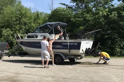 Lake St. Catherine Association Greeter inspecting a boat for aquatic invasive species.
